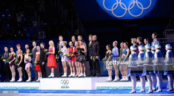 USA's Figure Skating team at right stands on the podium for a Bronze Medal during the ceremony for a Bronze finish in the team figure skating dance...