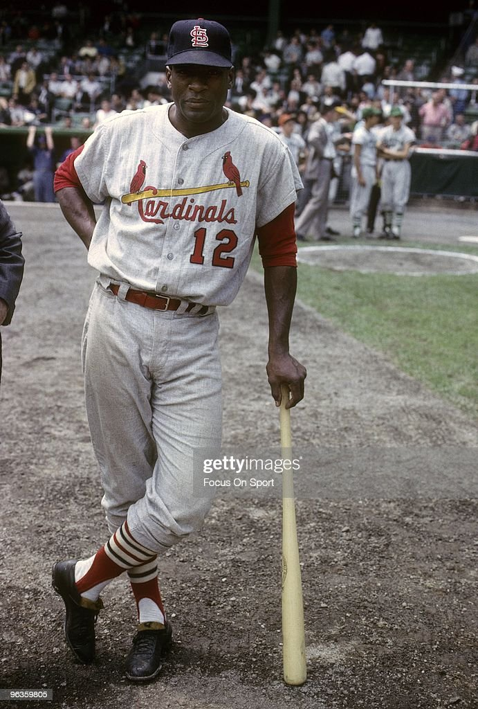 CIRCA 1960's: First Baseman Bill White #12 of the St. Louis Cardinals waiting his turn to hit during batting practice before a circa 1960's Major League Baseball game. White played for the Cardinals from 1959-65 and 1969.