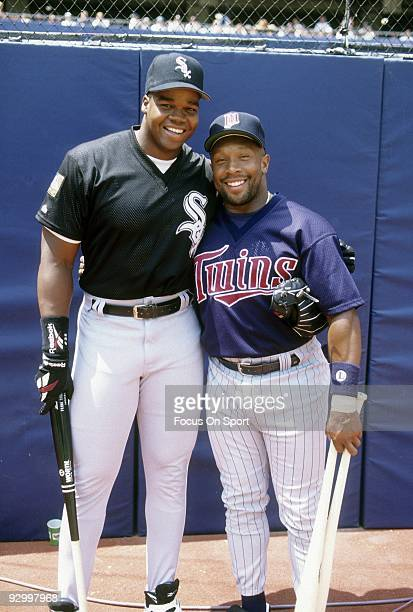 CIRCA 1990's First baseman Frank Thomas of the Chicago White Sox poses for the photo with Kirby Puckett of the Minnesota Twins before a circa mid...