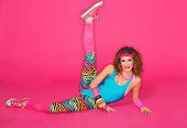 A 1980's fitness instructor against a pink background