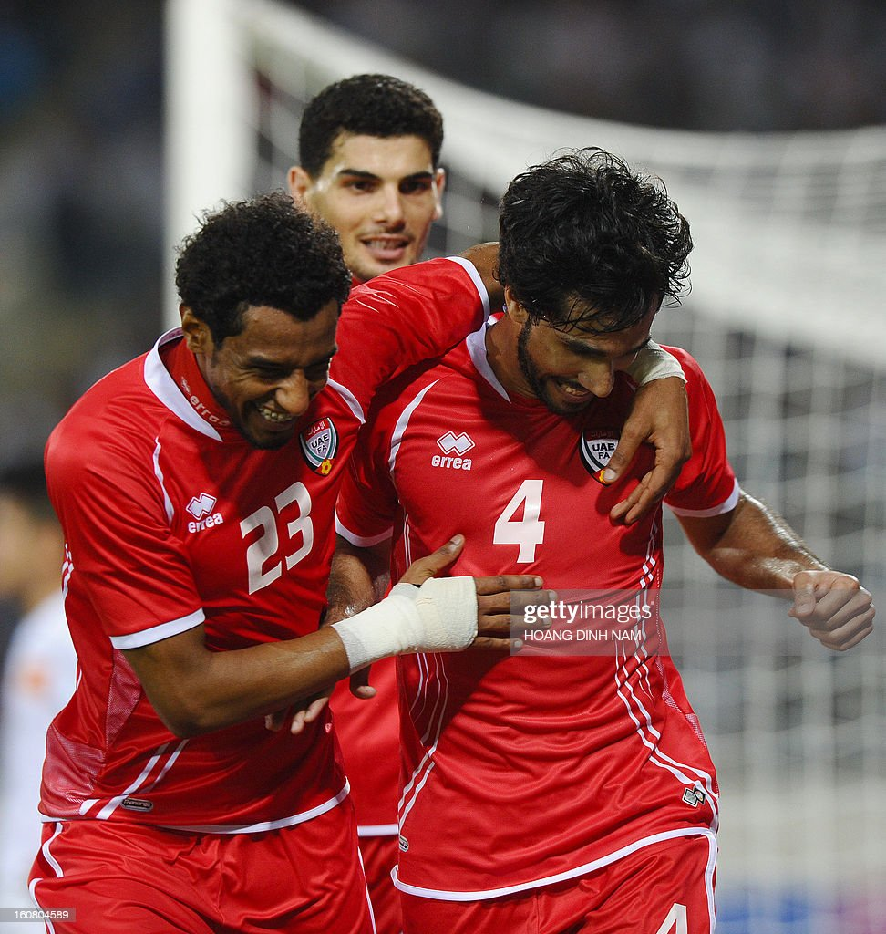 UAE's footballer Habib Al Fardan (R) celebrates with teammates after he scored the second and winning goal during the Asian Cup 2015 qualifying match Vietnam vs UAE in Hanoi on February 6, 2013. UAE won 2-1. AFP PHOTO/HOANG DINH Nam