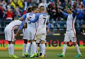 USA's footballers celebrate after Gyasi Zardes scored against Ecuador during their Copa America Centenario football tournament quarterfinal match in...