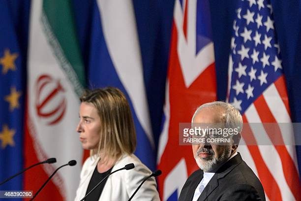 EU's foreign policy chief Federica Mogherini and Iranian Foreign Minister Mohammad Javad Zarif attend the announcement of an agreement on Iran...