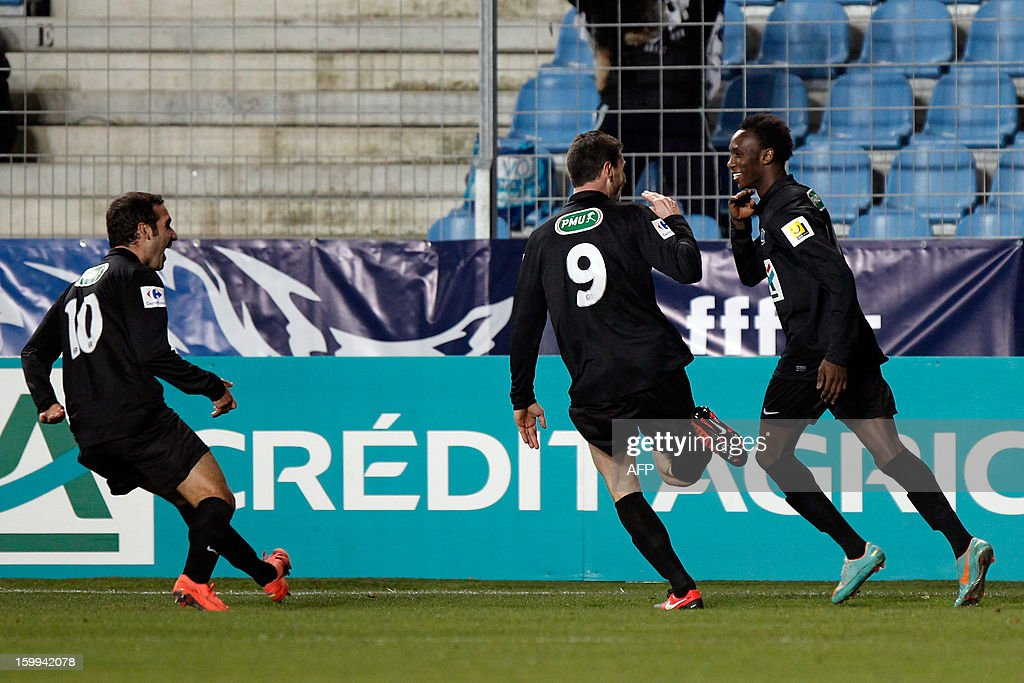 CAB's forward Alassane N'Diaye is congratulated by teammates after scoring a goal during the French Cup football match CA Bastia (CAB) vs Brest (SB29) in the Armand Cesari stadium in Bastia, Corsica, on January 23, 2013. AFP PHOTO / PASCAL POCHARD-CASABIANCA