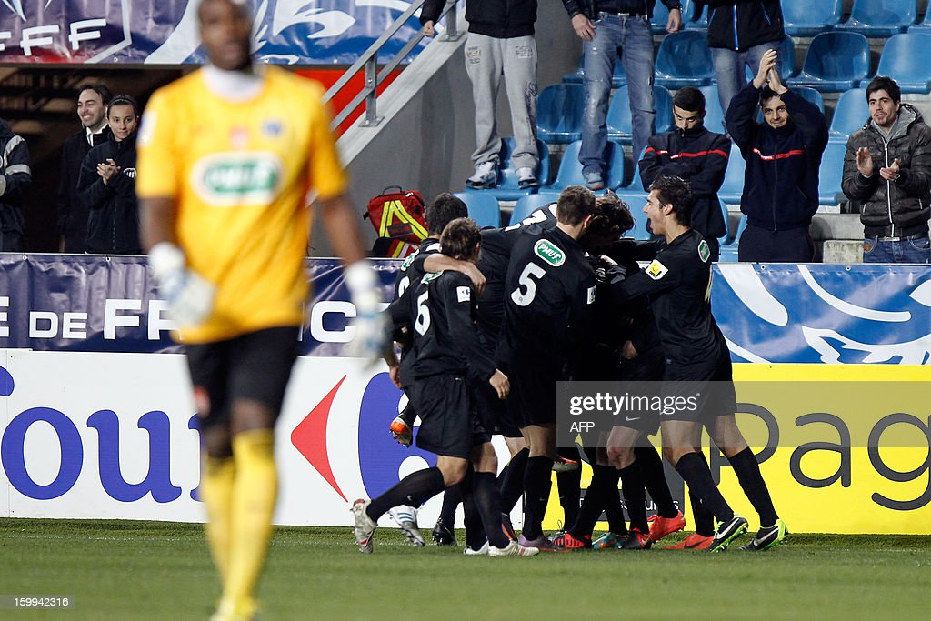 CAB's forward Alassane N'Diaye is congratulated by teammates after scoring a goal during the French football Cup match CA Bastia (CAB) vs Brest (SB29) at the Armand Cesari stadium in Bastia, French Mediterranean island of Corsica, on January 23, 2013.