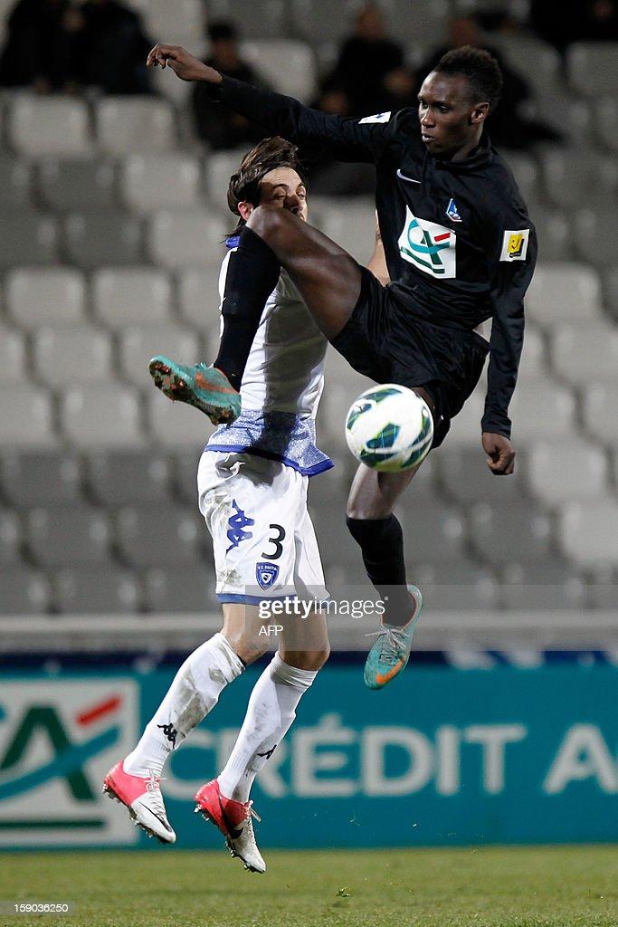 CAB's forward Alassane N'Diaye vies with Bastia's Algerian defender Fethi Harek during a French Football Cup match CA Bastia vs Sporting Club de...