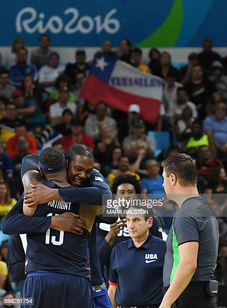 USA's forward Carmelo Anthony embraces USA's guard Kevin Durant during a Men's Gold medal basketball match between Serbia and USA at the Carioca...