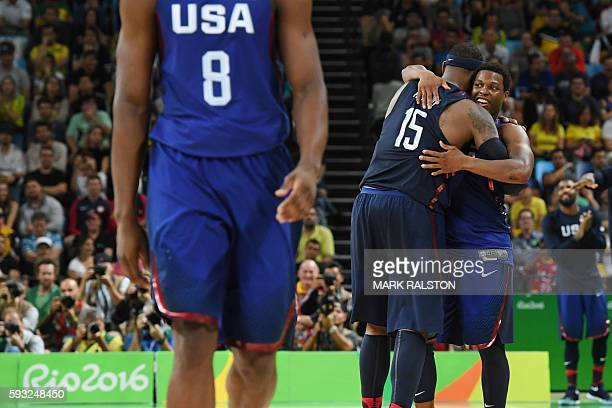 USA's forward Carmelo Anthony embraces USA's guard Kyle Lowry during a Men's Gold medal basketball match between Serbia and USA at the Carioca Arena...