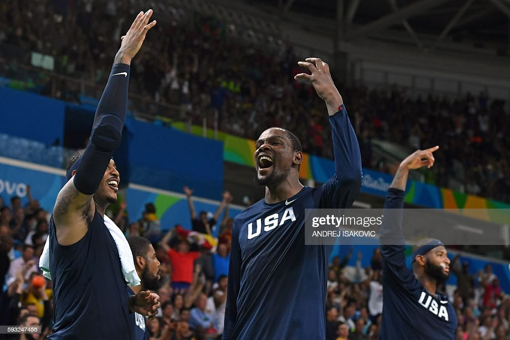 TOPSHOT USA's forward Carmelo Anthony USA's guard Kevin Durant and USA's centre DeMarcus Cousins react from the bench during the fourth quarter of a...