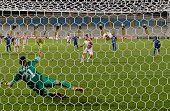 APOEL's forward defender Fernando Cavenaghi C scores from the penalty spot during the UEFA Europa League football match between APOEL and Asteras...