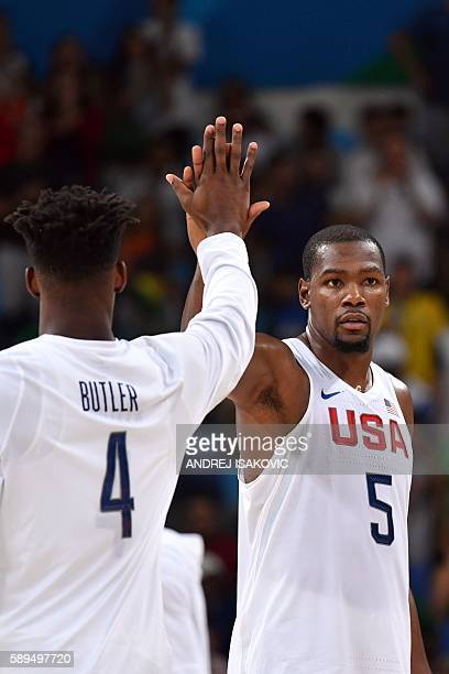 USA's forward Jimmy Butler and USA's guard Kevin Durant react after defeating France during a Men's round Group A basketball match between USA and...