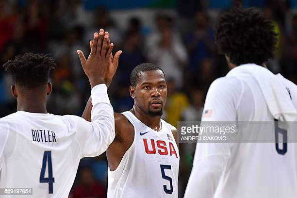 USA's forward Jimmy Butler USA's guard Kevin Durant and USA's centre DeAndre Jordan react after defeating France during a Men's round Group A...