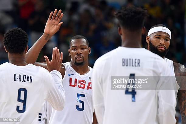 USA's forward Jimmy Butler USA's guard Kevin Durant USA's centre DeAndre Jordan and USA's centre DeMarcus Cousins react after defeating France during...