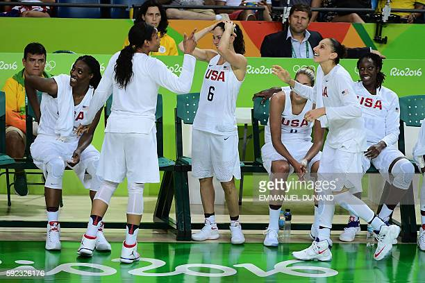 USA's forward Maya Moore jokes with USA's guard Sue Bird and USA's guard Diana Taurasi during a Women's Gold medal basketball match between USA and...