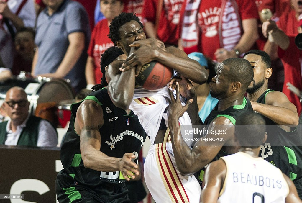 SIG's French center Bangaly Fofana vies with ASVEL's American center Darryl Watkins ASVEL's French small forward Charles Kahudi et ASVEL's American...