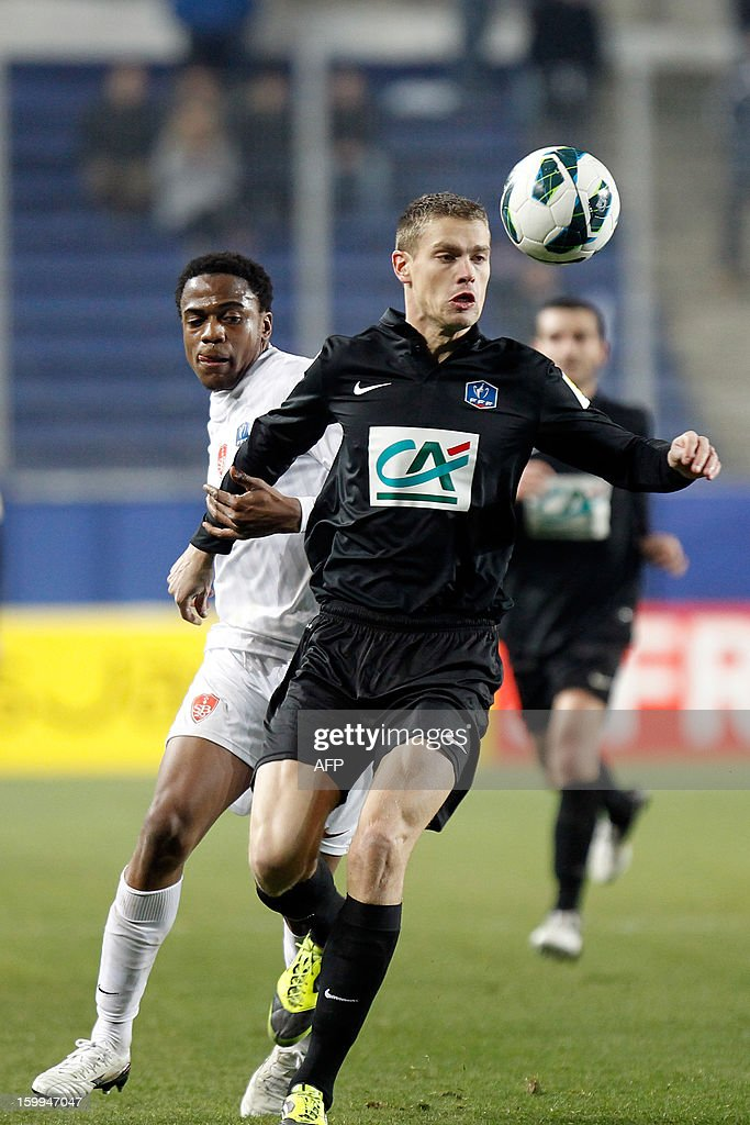 CAB's French forward Vincent Le Mat (L) vies with Brest's French midfielder Tripy Makonda during the French football Cup match CA Bastia (CAB) vs Brest (SB29) at the Armand Cesari stadium in Bastia, French Mediterranean island of Corsica, on January 23, 2013.