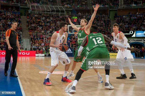 CSKA's French guard Nando de Colo vies with Baskonia's Spanish center Ilimane Diop and Slovenian guard Jaka Blazic during the Turkish Airlines...