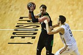 ASVEL's French power forward David Anderson vies with SIG's French small forward Jeremy Leloup during the Pro A Basketball game 1 of the final...