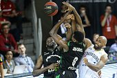 ASVEL's French small forward Charles Kahudi and ASVEL's French power forward Livio JeanCharles vies with SIG's American small forward Mardy Collins...
