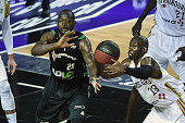 ASVEL's French small forward Charles Kahudi vies with SIG's American point guard Louis Campbell during the Pro A Basketball game 1 of the final...