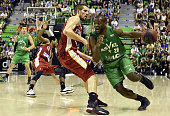 SIG's French small forward Jeremy Leloup vies with ASVEL's French small forward Charles Kahudi during the Pro A Basketball game 4 of the final match...