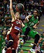 SIG's French small forward Paul Lacombe vies with ASVEL's American point guard Casper Ware during the Pro A Basketball game 3 of the final match...