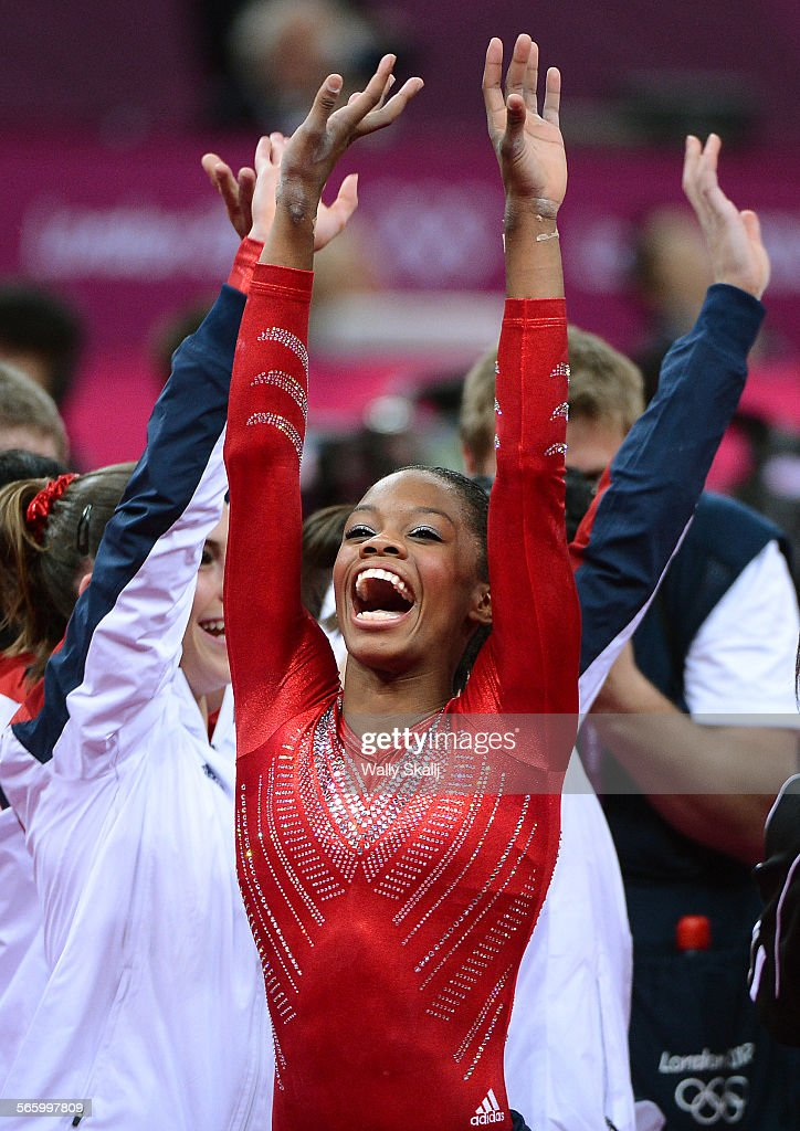 USA's Gabrielle Douglas celebrates the gold medal with teamates after winnin the Women's Team Final at the 2012 London Olympics Tuesday