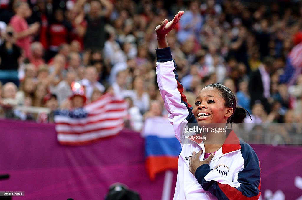 USA's Gabrielle Douglas waves to the crowd after winning the gold medal in the women's individual all–around at the 2012 London Olympics on Thursday