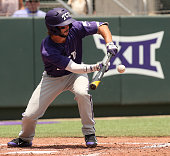 TCU's Garrett Crain hits a sacrifice bunt to advance a runner during the third inning of Game 2 of the NCAA Super Regional on Sunday June 7 at Lupton...