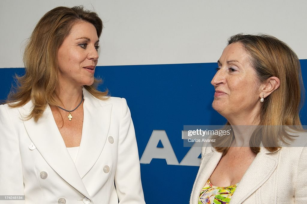 PP (Popular Party)'s General Secretary Maria Dolores de Cospedal (L) and Spain's Minister of Development Ana Pastor (R) attend the 'La Razon' newspaper meeting on July 22, 2013 in Madrid, Spain. Maria Dolores de Cospedal has said that the prime minister will go to parliament to talk about corruption cases involving the government.