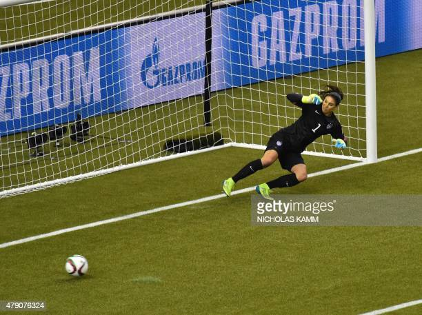 USA's goalkeeper Hope Solo watches as a penalty shot by Germany goes wide during their 2015 FIFA Women's World Cup semifinal match at Olympic Stadium...