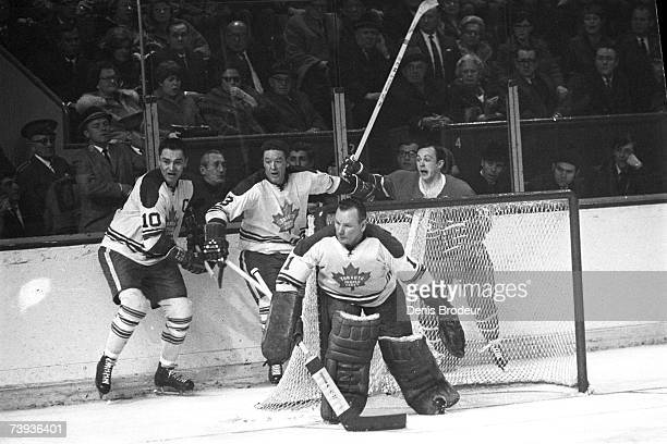MONTREAL QC JANUARY 1960's Goaltender Johnny Bower of the Toronto Maple Leafs defends the net against the Montreal Canadiens