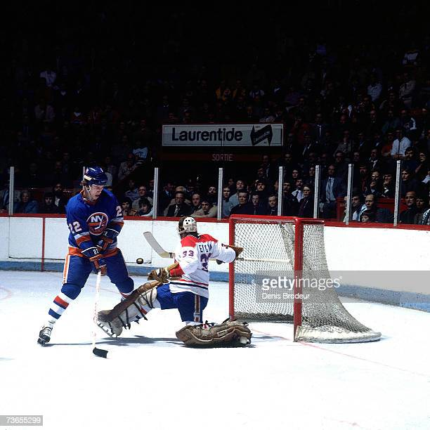 MONTREAL 1980's Goaltender Richard Sevigny of the Montreal Canadiens makes a save against Mike Bossy of the New York Islanders