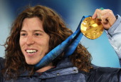 USA's gold medalist Shaun White celebrates on the podium during the medal ceremony of the men's snowboard halfpipe event of the Winter Olympics in...