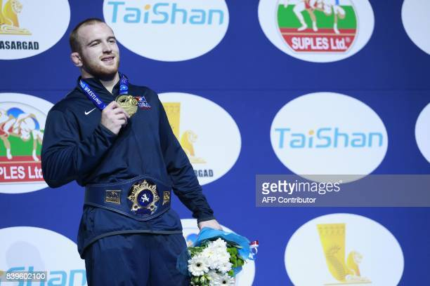 USA's gold medallist Kyle Snyder poses on the podium during the medal ceremony for the men's freestyle wrestling 97kg category at the FILA World...