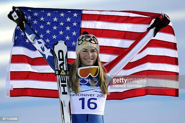 USA's gold medallist Lindsey Vonn poses for photographers in the finish area during the Women's downhill event on February 17 2010 at the Whistler...