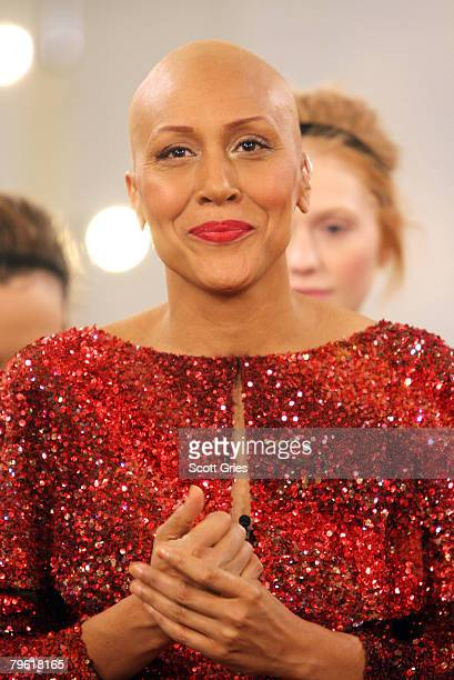 ABC's Good Morning America coanchor Robin Roberts who was recently diagnosed with breast cancer and completed chemotherapy takes a bow after walking...
