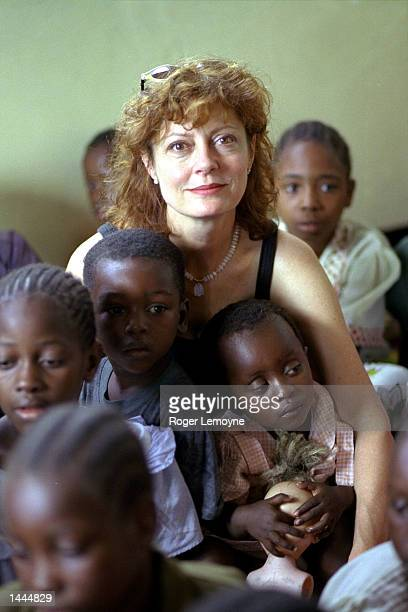 UNICEF''s Goodwill Ambassador Susan Sarandon sits amidst a group of children May 2000 and watches a song and dance performance by children at the...