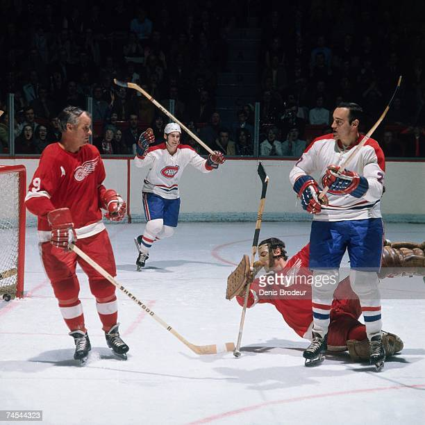 MONTREAL 1970's Gordie Howe of the Detroit Red Wings watches as the Montreal Canadiens celebrate a goal during their NHL game in Montreal Canada