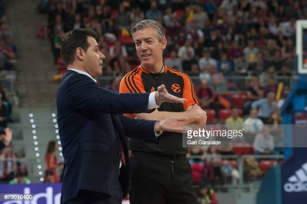 CSKA's Greek Head Coach Dimitris Itoudis argues with a referee during the Turkish Airlines Euroleague Basketball Playoff 3rd game between Baskonia...