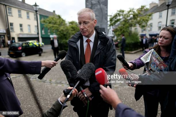 DUP's Gregory Campbell speaks to the media in Castlederg County Tyrone ahead of the controversial parade by IRA supporters