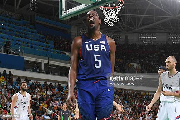 USA's guard Kevin Durant celebrates after scoring during a Men's Gold medal basketball match between Serbia and USA at the Carioca Arena 1 in Rio de...
