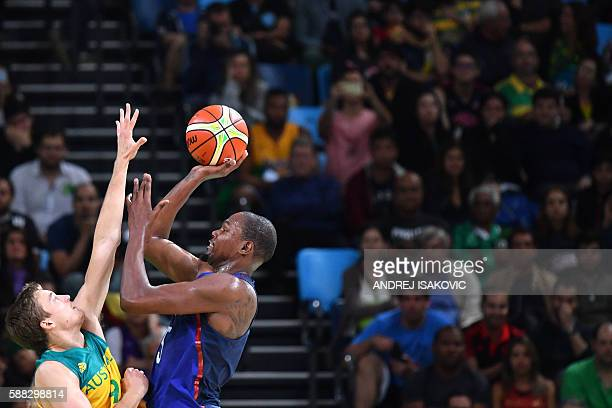 TOPSHOT USA's guard Kevin Durant jumps to score by Australia's forward Ryan Broekhoff during a Men's round Group A basketball match between Australia...