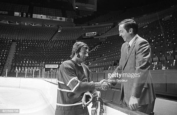 MONTREAL QC CIRCA 1960's Guy LaFleur and Jean Beliveau of the Montreal Canadiens pose for a photo at the Montreal Forum circa 1960 in Montreal Quebec...
