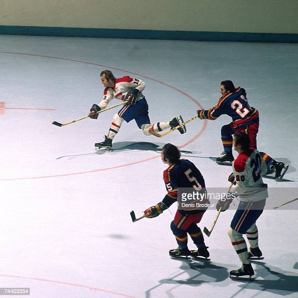 MONTREAL QC 1980's Guy Lafleur of the Montreal Canadiens shoots the puck during an NHL game in Montreal Canada
