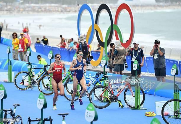 USA's Gwen Jorgensen and Switzerland's Nicola Spirig compete in the running portion of the women's triathlon at Fort Copacabana during the Rio 2016...