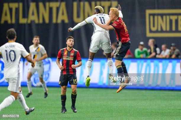 LA's Gysai Zardes and Atlanta's Jeff Larentowicz go high for a header during a match between Atlanta United and LA Galaxy on September 20 2017 at...