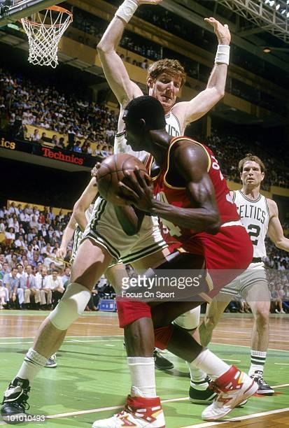 BOSTON MA CIRCA 1980's Hakeem Olajuwon of the Houston Rockets is guarded closely by Bill Walton of the Boston Celtics circa mid 1980's during an NBA...