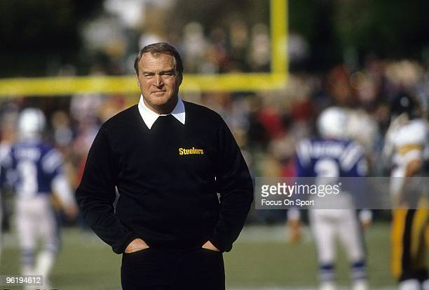 BALTIMORE MA CIRCA 1970's Head Coach Chuck Noll of the Pittsburgh Steelers on the field watching his team warmup prior to the start of a mid circa...