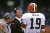 CLEVELAND OH CIRCA 1980's Head Coach Marty Schottenheimer of the Cleveland Browns talks with his quarterback Bernie Kosar on the sidelines during a...